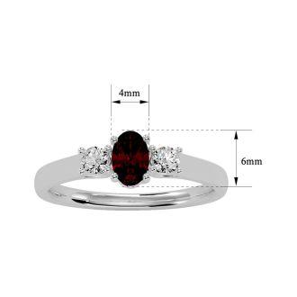 3/4 Carat Oval Shape Garnet and Two Diamond Ring In 14 Karat White Gold
