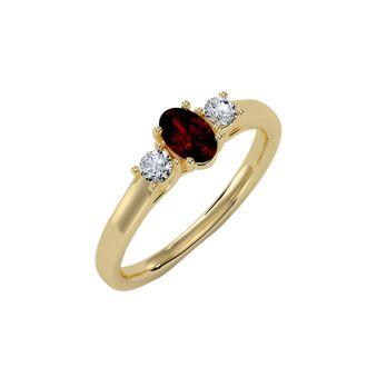 3/4 Carat Oval Shape Garnet and Two Diamond Ring In 14 Karat Yellow Gold