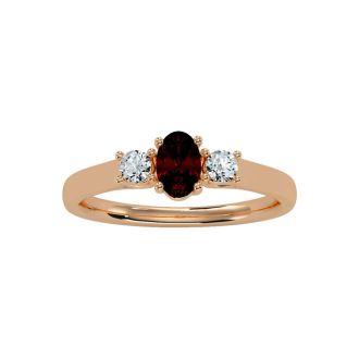 3/4 Carat Oval Shape Garnet and Two Diamond Ring In 14 Karat Rose Gold