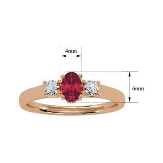 3/4 Carat Oval Shape Ruby and Two Diamond Ring In 14 Karat Rose Gold