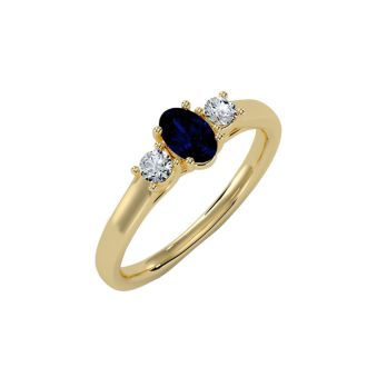 3/4 Carat Oval Shape Sapphire and Two Diamond Ring In 14 Karat Yellow Gold