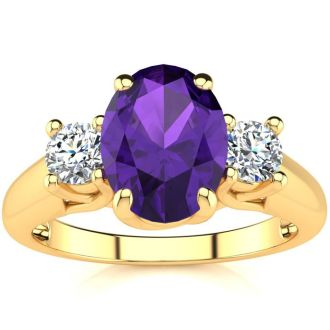 1 1/4 Carat Oval Shape Amethyst and Two Diamond Ring In 14 Karat Yellow Gold