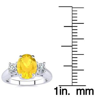 1 1/4 Carat Oval Shape Citrine and Two Diamond Ring In 14 Karat White Gold