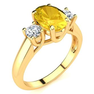 1 1/4 Carat Oval Shape Citrine and Two Diamond Ring In 14 Karat Yellow Gold