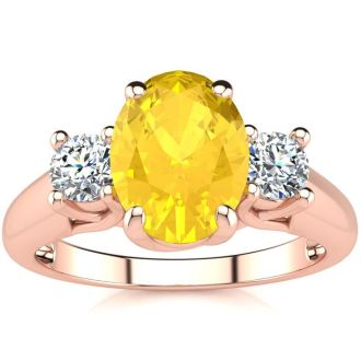 1 1/4 Carat Oval Shape Citrine and Two Diamond Ring In 14 Karat Rose Gold