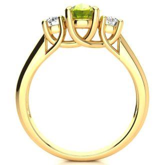 1 1/2 Carat Oval Shape Peridot and Two Diamond Ring In 14 Karat Yellow Gold