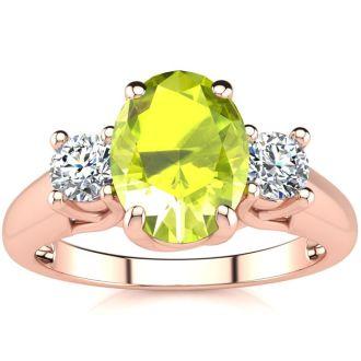1 1/2 Carat Oval Shape Peridot and Two Diamond Ring In 14 Karat Rose Gold
