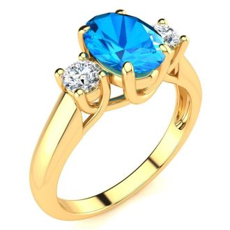 1 3/4 Carat Oval Shape Blue Topaz and Two Diamond Ring In 14 Karat Yellow Gold
