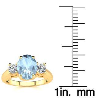 1 1/3 Carat Oval Shape Aquamarine and Two Diamond Ring In 14 Karat Yellow Gold