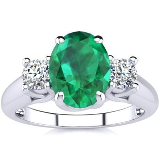 1 1/3 Carat Oval Shape Emerald and Two Diamond Ring In 14 Karat White Gold