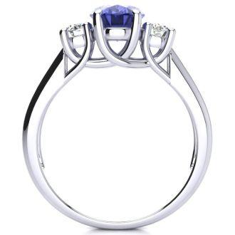 1 1/2 Carat Oval Shape Tanzanite and Two Diamond Ring In 14 Karat White Gold