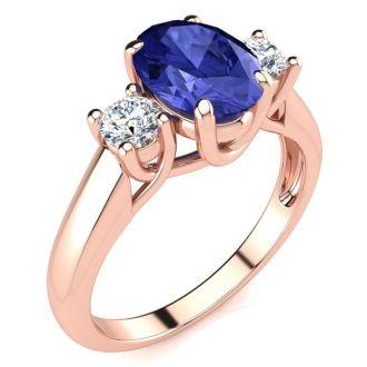 1 1/2 Carat Oval Shape Tanzanite and Two Diamond Ring In 14 Karat Rose Gold