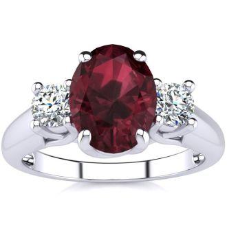 1 3/4 Carat Oval Shape Garnet and Two Diamond Ring In 14 Karat White Gold