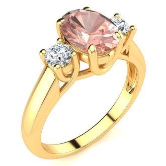 1 1/3 Carat Oval Shape Morganite and Two Diamond Ring In 14 Karat Yellow Gold