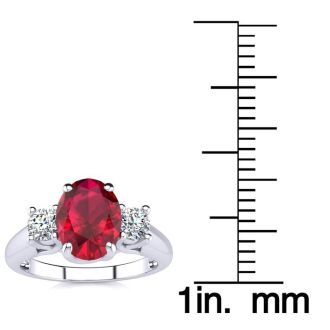 1 3/4 Carat Oval Shape Ruby and Two Diamond Ring In 14 Karat White Gold