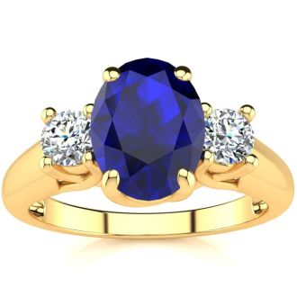 1 3/4 Carat Oval Shape Sapphire and Two Diamond Ring In 14 Karat Yellow Gold
