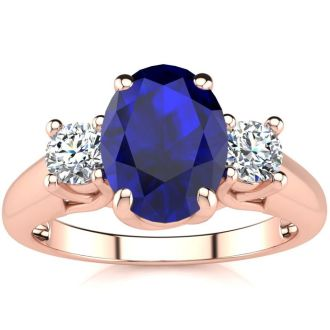 1 3/4 Carat Oval Shape Sapphire and Two Diamond Ring In 14 Karat Rose Gold