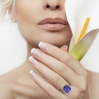 4 Carat Tanzanite and Halo Diamond Ring In 14 Karat Yellow Gold