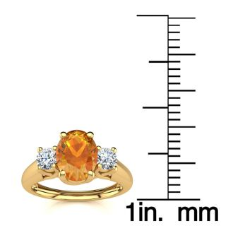 1 Carat Oval Shape Citrine and Two Diamond Ring In 14 Karat Yellow Gold