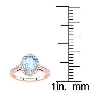 1 Carat Oval Shape Aquamarine and Halo Diamond Ring In 14 Karat Rose Gold