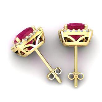 6 3/4 Carat Cushion Cut Ruby and Halo Diamond Stud Earrings In 14 Karat Yellow Gold