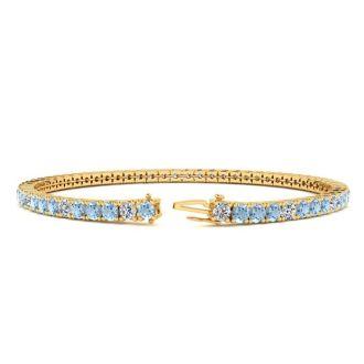 4 Carat Aquamarine And Diamond Graduated Tennis Bracelet In 14 Karat Yellow Gold, 7 Inches