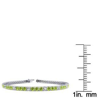 4 Carat Peridot And Diamond Alternating Tennis Bracelet In 14 Karat White Gold, 7 Inches