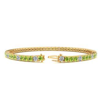 4 Carat Peridot And Diamond Alternating Tennis Bracelet In 14 Karat Yellow Gold, 7 Inches