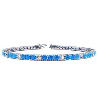 5 Carat Blue Topaz And Diamond Alternating Tennis Bracelet In 14 Karat White Gold, 7 Inches