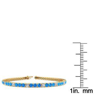 5 Carat Blue Topaz And Diamond Alternating Tennis Bracelet In 14 Karat Yellow Gold, 7 Inches