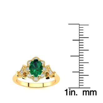 1 Carat Oval Shape Emerald and Halo Diamond Vintage Ring In 14 Karat Yellow Gold