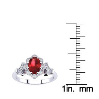 1 Carat Oval Shape Ruby and Halo Diamond Vintage Ring In 14 Karat White Gold