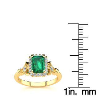1 Carat Emerald and Halo Diamond Vintage Ring In 14 Karat Yellow Gold