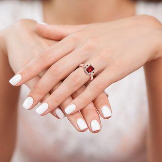 1 1/4 Carat Ruby and Halo Diamond Vintage Ring In 14 Karat Rose Gold