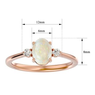1 Carat Oval Shape Opal and Two Diamond Ring In 14 Karat Rose Gold