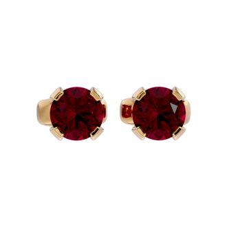 0.60 Carat Ruby Stud Earrings in Yellow Gold