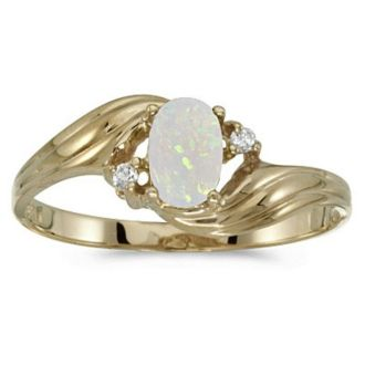 1/4ct Oval Opal And .02ct Diamond Ring in 10k Yellow Gold