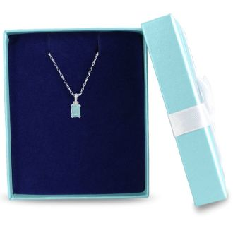 1ct Blue Topaz and Diamond Emerald Cut Pendant in Sterling Silver