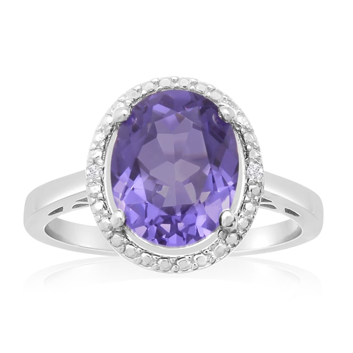 781e6b63c Tanzanite and Diamond Halo Ring In Sterling Silver