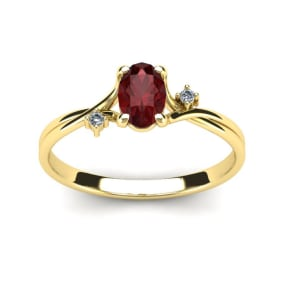 1/2 Carat Oval Shape Garnet and Two Diamond Accent Ring In 14 Karat Yellow Gold