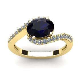 1 3/4 Carat Oval Shape Sapphire and Halo Diamond Ring In 14 Karat Yellow Gold