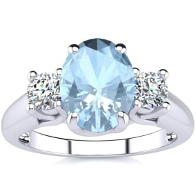 1 1/3 Carat Oval Shape Aquamarine and Two Diamond Ring In 14 Karat White Gold