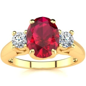 1 3/4 Carat Oval Shape Ruby and Two Diamond Ring In 14 Karat Yellow Gold
