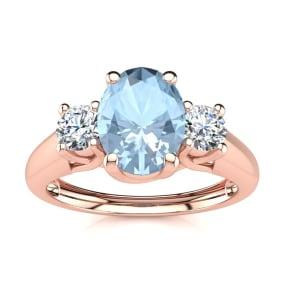 1 Carat Oval Shape Aquamarine and Two Diamond Ring In 14 Karat Rose Gold