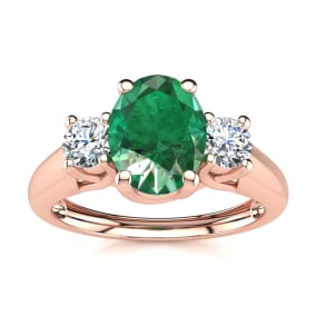 1 Carat Oval Shape Emerald and Two Diamond Ring In 14 Karat Rose Gold