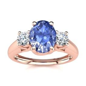 1.15 Carat Oval Shape Tanzanite and Two Diamond Ring In 14 Karat Rose Gold