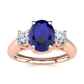 1 1/5 Carat Oval Shape Sapphire and Two Diamond Ring In 14 Karat Rose Gold
