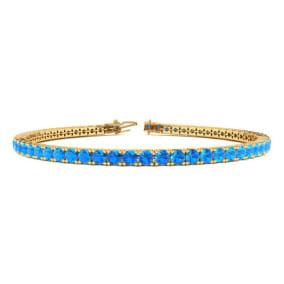 5 1/2 Carat Blue Topaz Tennis Bracelet In 14 Karat Yellow Gold Available In 6-9 Inch Lengths
