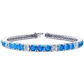 11 2/3 Carat Blue Topaz and Diamond Graduated Tennis Bracelet In 14 Karat White Gold Available In 6-9 Inch Lengths
