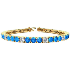 11 2/3 Carat Blue Topaz and Diamond Graduated Tennis Bracelet In 14 Karat Yellow Gold Available In 6-9 Inch Lengths